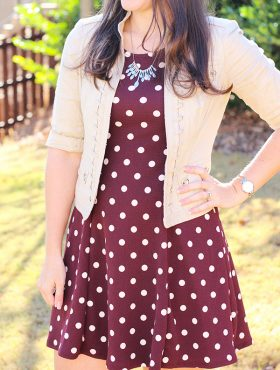 image of Lindsay wearing maroon dress with white polka dots and tan jacket from Stitch Fix