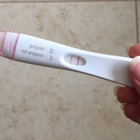 close up image of positive pregnancy test