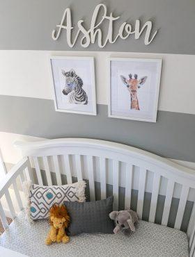 overhead image of Ashton's crib and wall decor