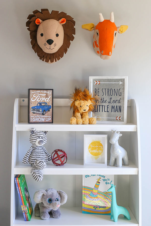 image of bookshelf and wall decor in nursery