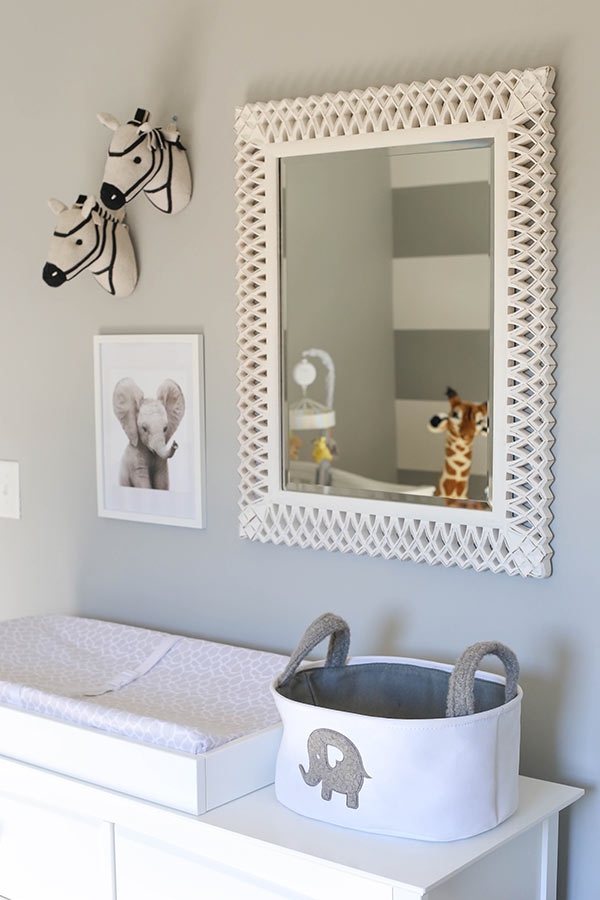 image of mirror and decor above changing table