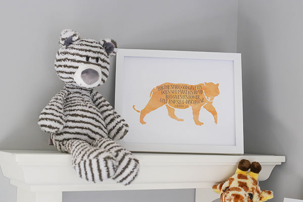 image of stuffed bear and framed sign on shelf