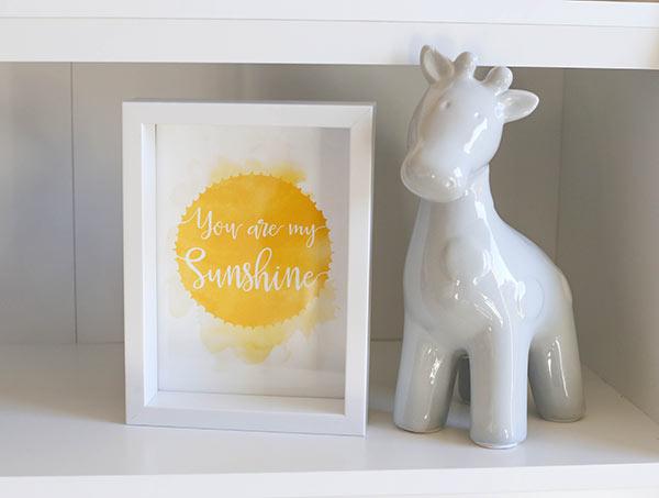 You are My Sunshine sign and ceramic giraffe on shelf