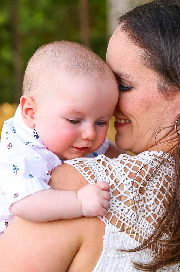 close up image of Lindsay holding Ashton