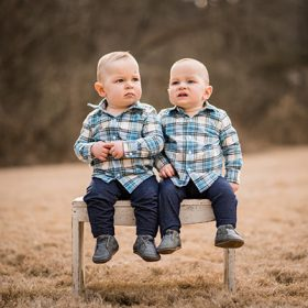 image of the twins sitting on a bench